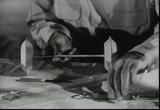 Still frame from: As the Wheels Turn
