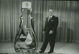 Still frame from: 1957 Commercial for White Rain Shampoo