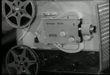 Still frame from: 1961 Classic TV Commercial for ''Kodak Brownie Film Projector''