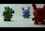 Still frame from: ART TOYS Kaws Kid Robot Futura