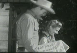 Still frame from: ''Annie Oakley'' - Santa Claus Wears a Gun