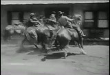 Still frame from: Broadway to Cheyenne