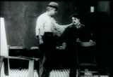 Still frame from: Charlie Chaplin's 'Behind The Screen'