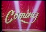 Still frame from: Drive-in: Coming-Red Curtain-Searchlights