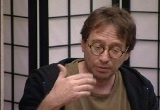 Still frame from: Improv 21: = Q + A: An Informance with John Zorn