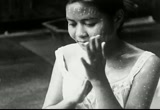Still frame from: In Siamese Society