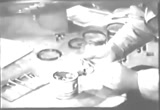 Still frame from: Inspecting & Reconditioning Piston Assembly