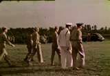 Still frame from: [Home Movies: Lloyd Spooner, Inspecting Paratroopers Troops]
