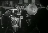 Still frame from: Man With a Camera - Close-up on Violence