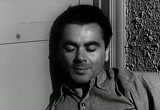Still frame from: Man With a Camera - The Face of Murder