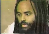 Still frame from: Millions for Mumia