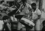 Still frame from: Music from Oil Drums