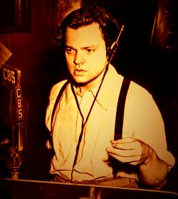 Orson Welles at old style microphone