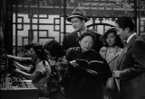 Still frame from: Phantom of Chinatown