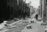 Still frame from: Place to Live, A