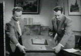 Still frame from: Public Prosecutor - Case Of The Comic-Strip Murder (1948)