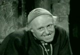 Still frame from: The Miser