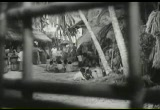 Still frame from: The Beachcomber