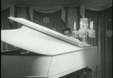 Still frame from: The Liberace Show - 1954 Christmas episode