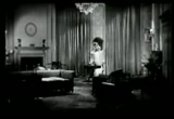 Still frame from: Woman to Woman 1929