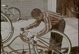 Still frame from: Bicycle Today, Automobile Tomorrow