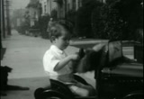 Still frame from: [Home movies. James David Zellerbach. Bike Riding, Children Playing, Indoor Swimming Pool Scenes]