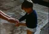 Still frame from: [Home movies. Stephen A. Zellerbach. Little Boy with Bicycle]