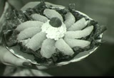 Still frame from: Florida Citrus: Canned Grapefruit Sections, 1950s (dmbb01842)
