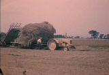 Still frame from: Hand Methods of Harvesting Hay