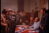 Still frame from: The Klansman