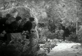 Still frame from: They Raid By Night
