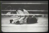 Still frame from: Girl Wrestlers Mix It In Furious Championship Bout
