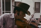 Still frame from: Fiddler, The