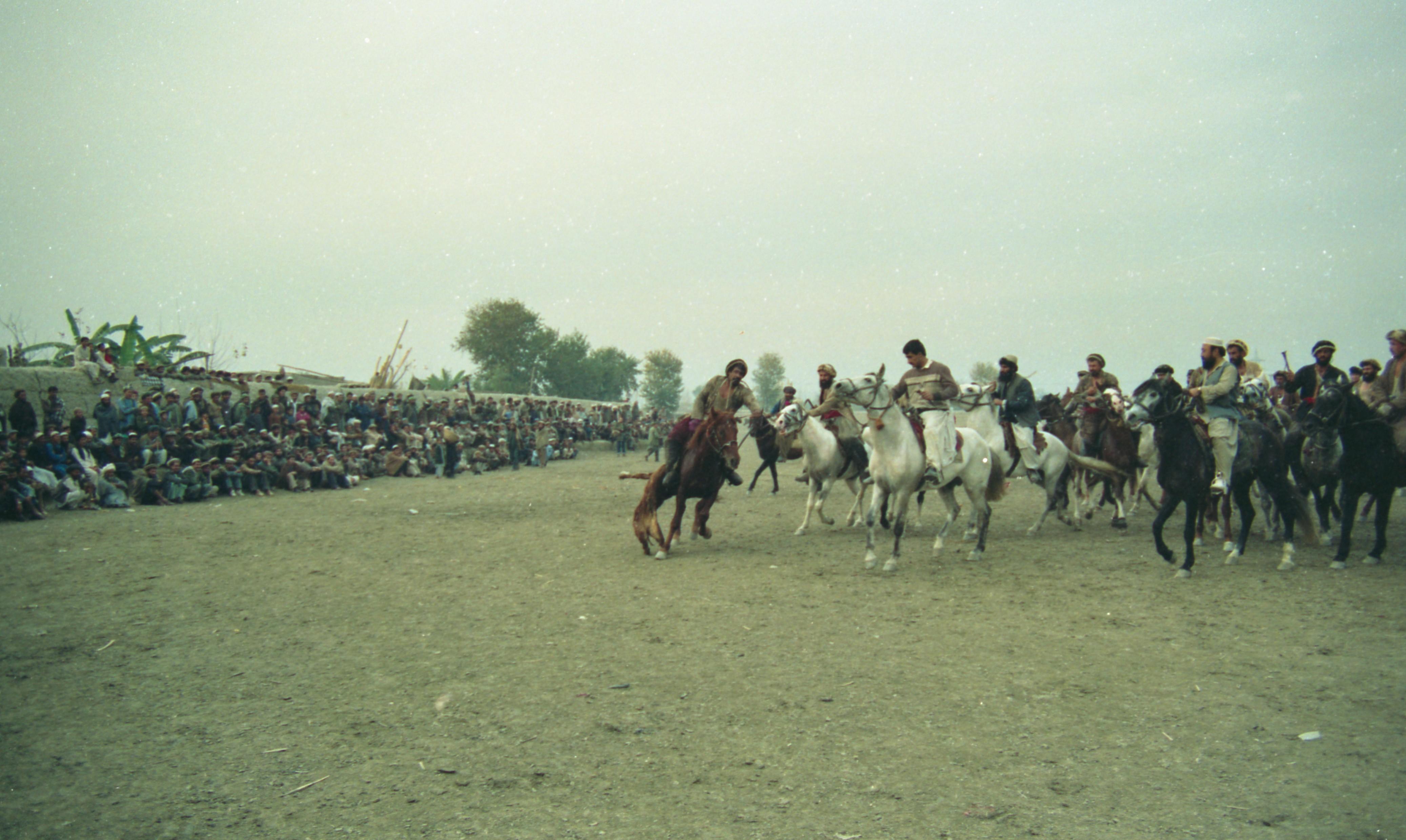 Afghan refugees playing Buzkashī (Goat grabbing) game  : Ahmad Shah
