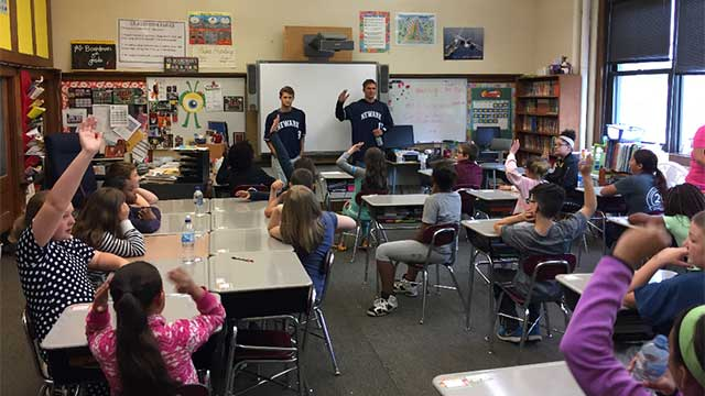 Newark Pilots players visit with Lyons students on Tuesday morning