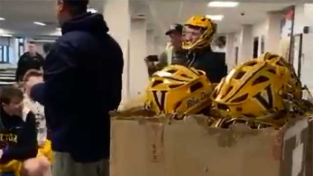 Victor laxers surprised with shiny new helmets