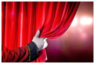 White-gloved-hand-pulling-back-red-theatre-curtain